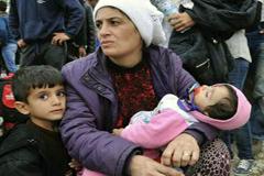 Refugiada siria y sus hijos (UN)