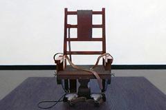 Silla eléctrica símbolo de la pena de muerte (AI)